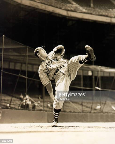 Pitcher Bob Feller of the Cleveland Indians poses for an action portrait Feller played for the Indians from 193656