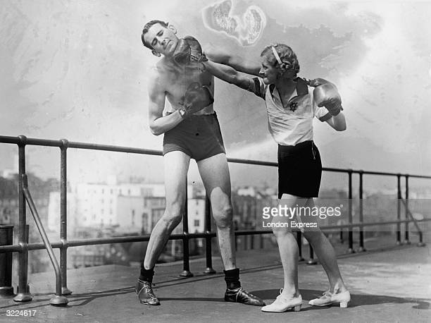 Beatrice Lillywhite lands a punch on George Cox's jaw