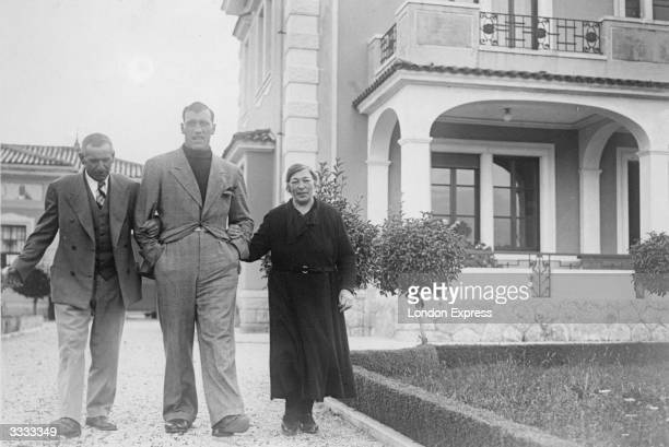 Italian heavyweight boxer Primo Carnera with his mother and father at home in Italy