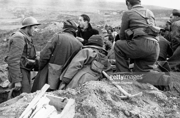 News reporters mingle with members of the International Brigade amongst them is Ernest Hemingway during the Spanish Civil War