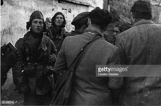 News reporters mingling with members of the International Brigade during the Spanish Civil War Amongst them is American novelist and journalist...