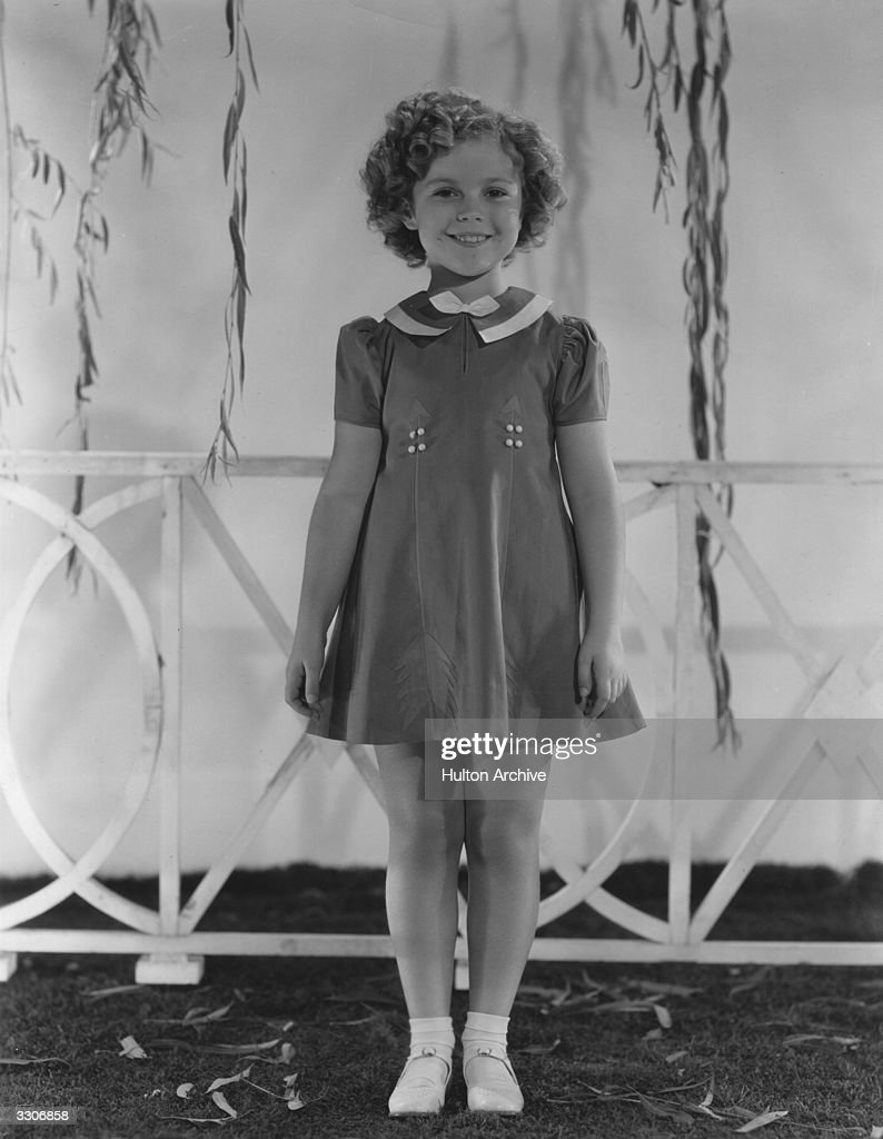 <a gi-track='captionPersonalityLinkClicked' href=/galleries/search?phrase=Shirley+Temple&family=editorial&specificpeople=69996 ng-click='$event.stopPropagation()'>Shirley Temple</a> (1928 - ) the American child star started performing in films at three years. She entered politics in the 60's and took on several ambassador positions representing her country. Pictured, wearing a very pretty day dress.