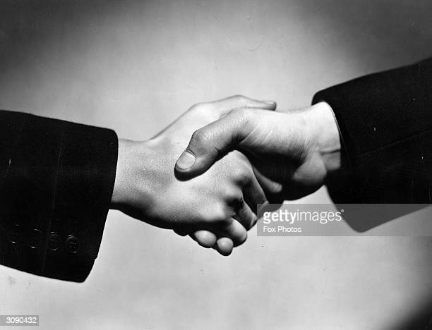 A closeup of a pair of hands clasped in friendship