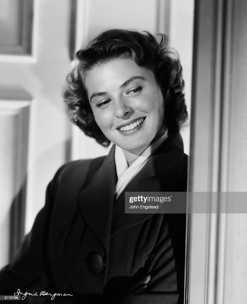 A happy film star; <a gi-track='captionPersonalityLinkClicked' href=/galleries/search?phrase=Ingrid+Bergman&family=editorial&specificpeople=70003 ng-click='$event.stopPropagation()'>Ingrid Bergman</a> (1915 - 1952) leans against a doorway.