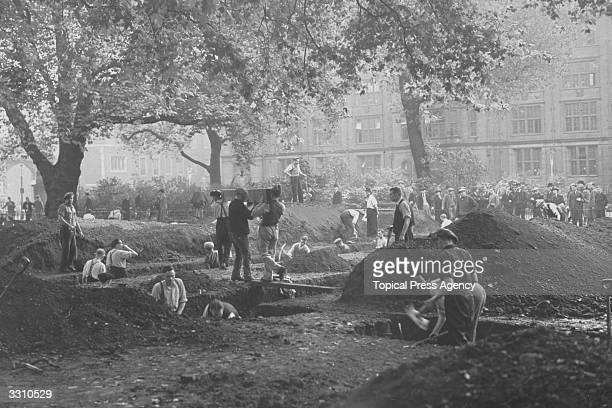 Air raid shelter trenches being dug in a miniature golf course in Lincoln's Inn Fields London