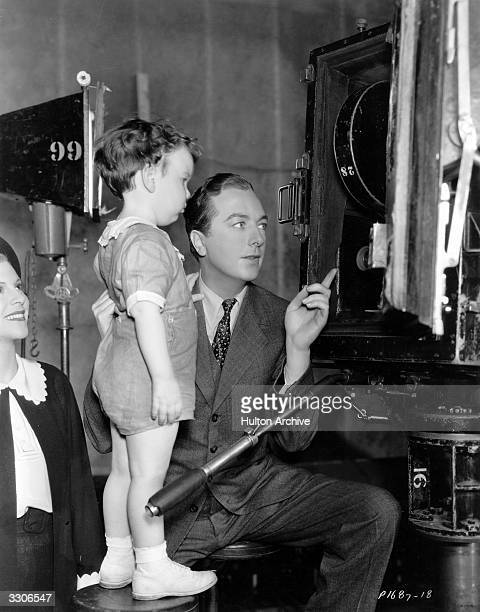 Film comedian Jack Haley shows his son around the 'F Man' set at Paramount studios