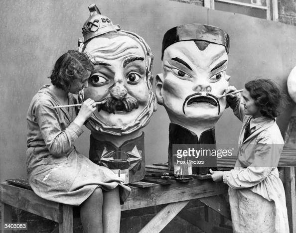 Giant pantomime heads being decorated at the Pytree papier mache factory in New Malden Surrey