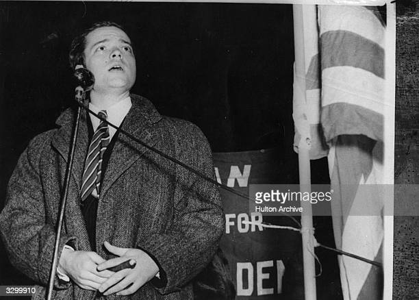 Orson Welles broadcasting at a mass demonstration in New York