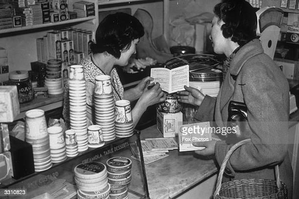A woman seen here registering her family with a grocer for rations of bacon ham butter and sugar