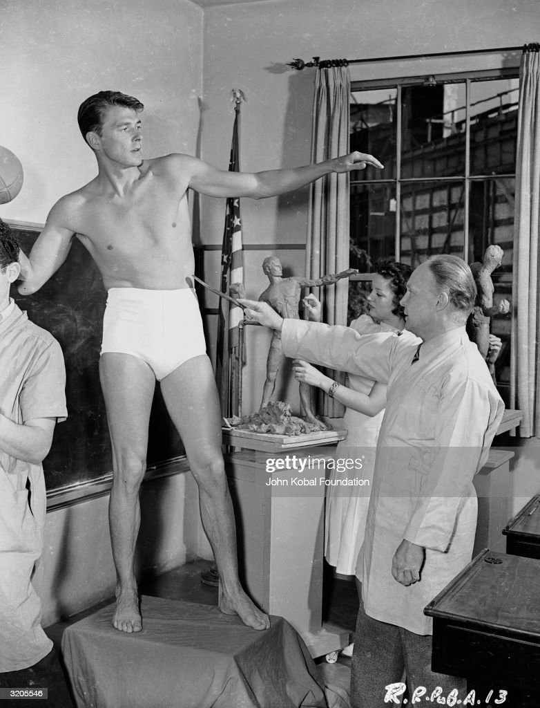 American leading man and future US President Ronald Reagan modelling for a sculpture