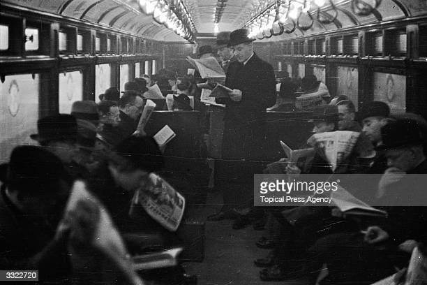 Commuters travelling by train at Waterloo Railway Station London
