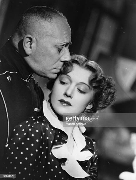Erich von Stroheim as Count von Ludow in an affectionate moment with Edwige Feuillere from the film 'Marthe Richard Au Service De La France'