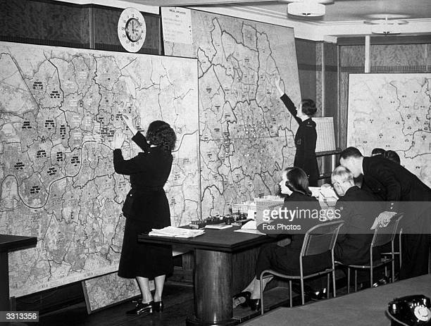 Members of the Auxiliary Fire Service at work in the air raid control room of the London Region headquarters