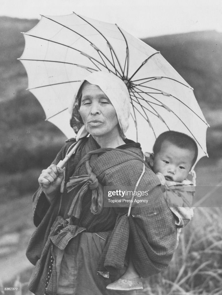 A Japanese peasant with her child.