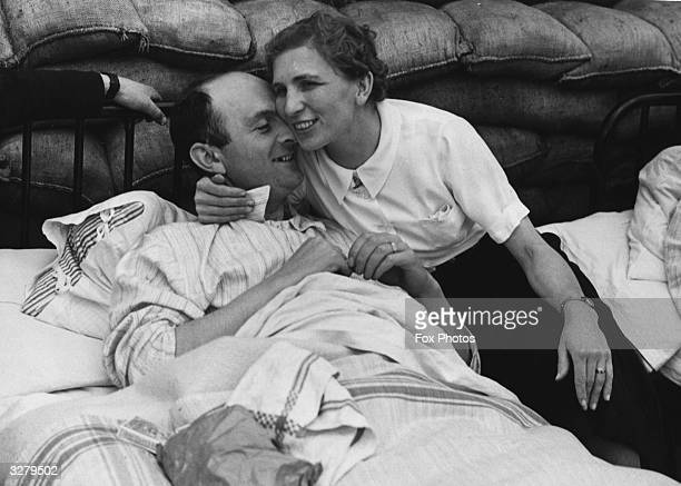 A wife visits her husband in a military hospital