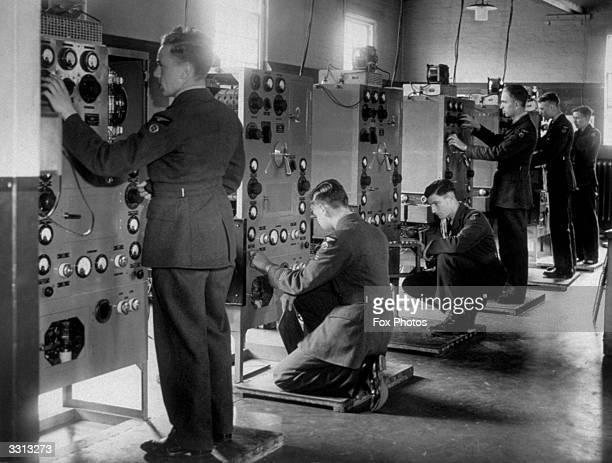 Apprentices being trained in wireless control at a Royal Air Force station somewhere in England