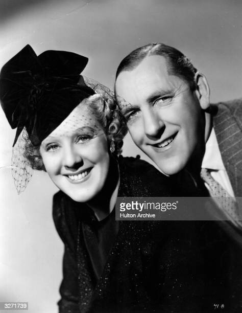 Comedy double act and reallife couple Cicely Courtneidge and Jack Hulbert star in the spy film ' Under Your Hat' directed by Maurice Elvey for...