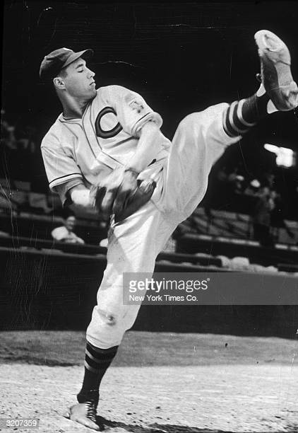Fulllength image of baseball pitcher Bob Feller of the Cleveland Indians winding up for a pitch during practice