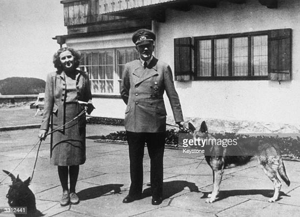 Hitler with Eva Braun his supposed wife photographed with their dogs at Berchtesgaden The picture is from a photograph album belonging to Eva Braun...
