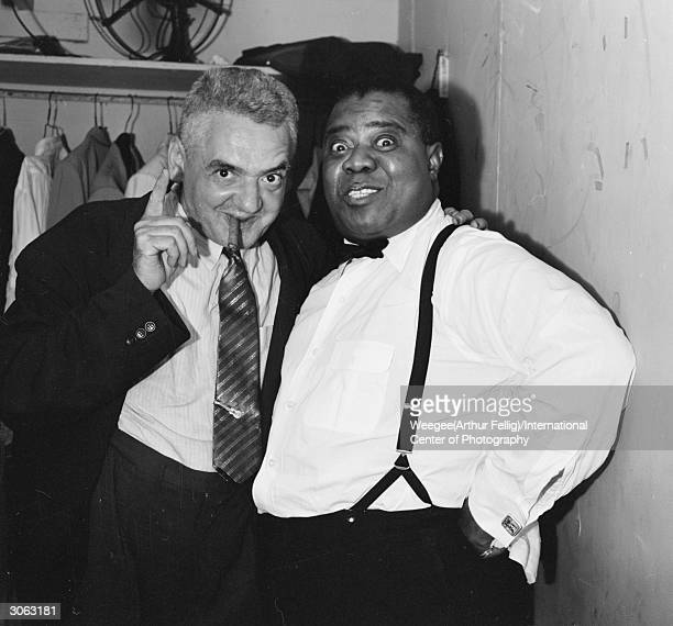 Jazz trumpeter and singer Louis Armstrong backstage at Basin Street New York with Polishborn American photographer Arthur 'Weegee' Fellig Photo by...