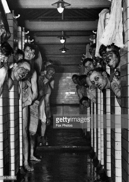 Miners taking a shower following a shift down the coal pit