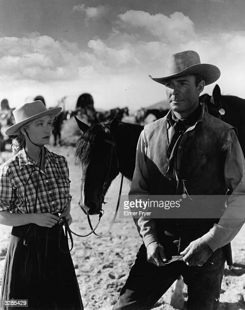 Miriam Hopkins the American leading lady and Randolph Scott the rugged American outdoor star in a scene from 'Virginia City' directed by Michael...