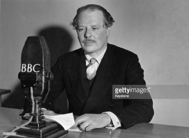 Sir Harold Nicolson English diplomat author and critic sitting before a BBC microphone in a radio studio