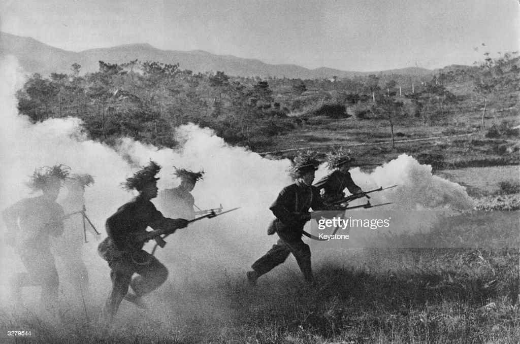 The front line troops of the Japanese Army charge forward during World War II