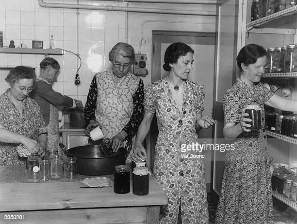 Women making jams and preserves in a professional kitchen during World War II