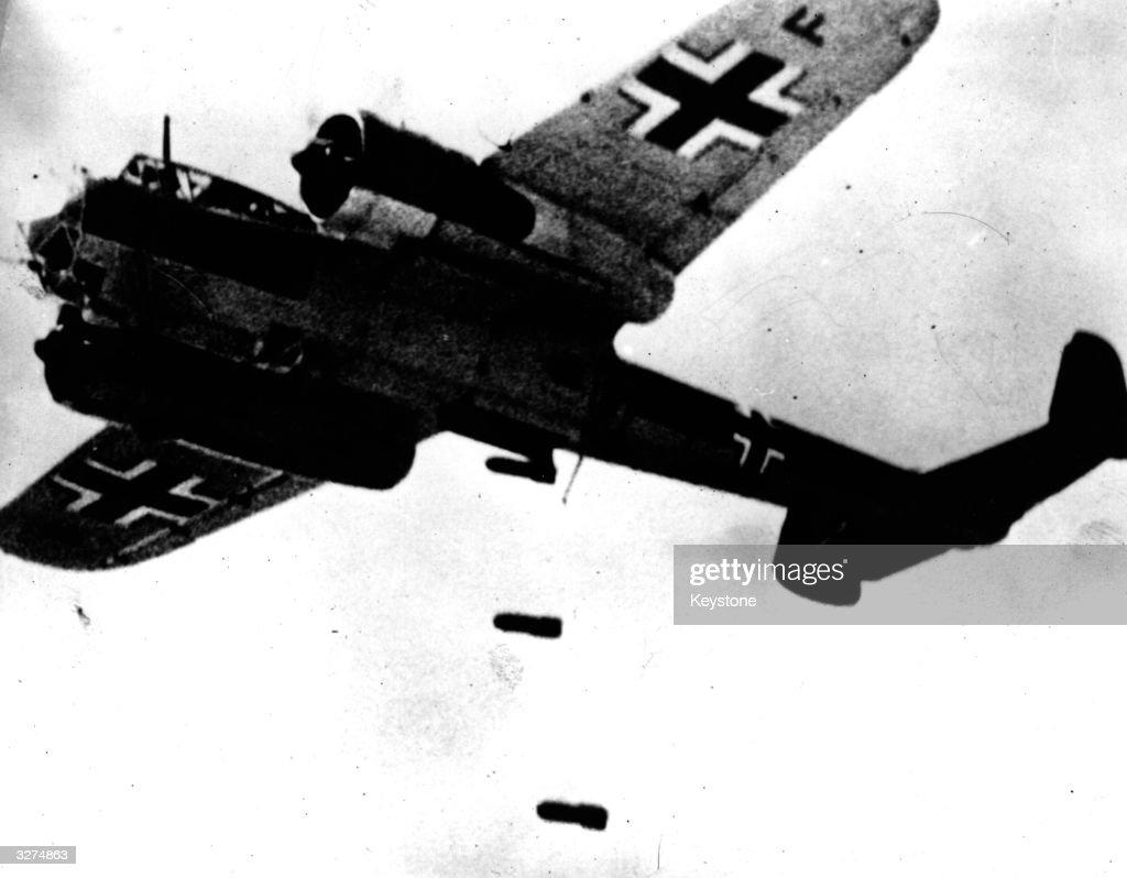 A German Dornier DO17 bomber unloading bombs during the Battle of Britain