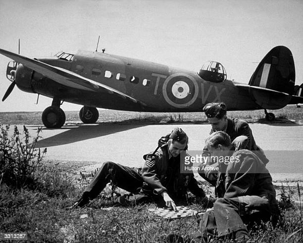 A group of Royal Air Force bomber pilots who bombed the Battleship Scharnhorst playing draughts