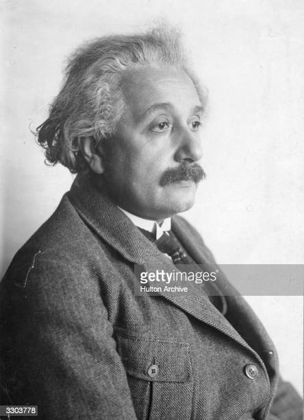 A nearprofile of Albert Einstein the GermanSwissAmerican mathematical atomic physicist and Nobel prizewinner looking pensive