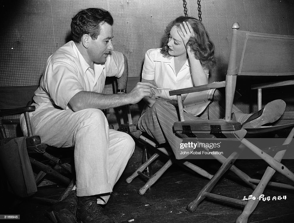 Hollywood director William Wyler (1902 - 1981) on the set of 'The Little Foxes' with actress Bette Davis (1908 - 1989).