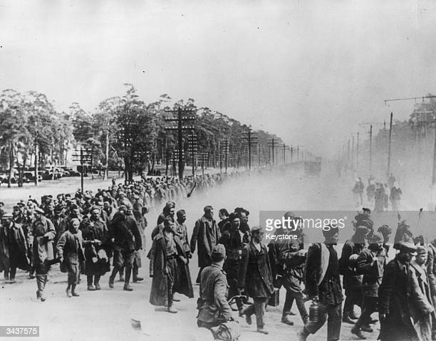 Hundreds of Soviet prisoners being marched to an internment camp by their German guards during World War II