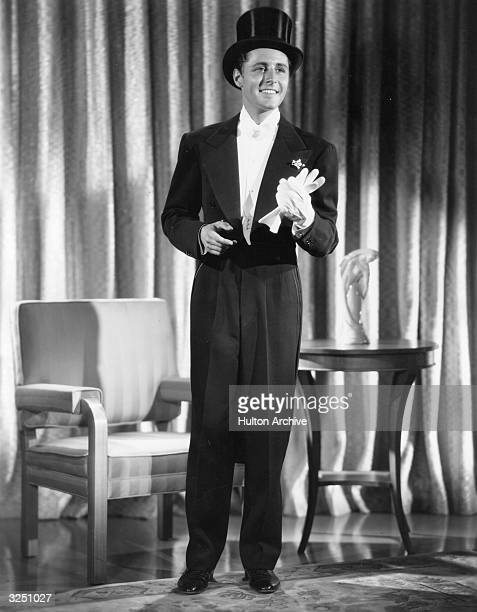 Thomas Beck the American actor is pictured modelling an after dinner ensemble from his own wardrobe comprising a dinner suit made of lightweight deep...
