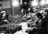 A group of young women making hand grenades at a Moscow munitions plant The two girls in the foreground are members of the Stakhanov Movement and...