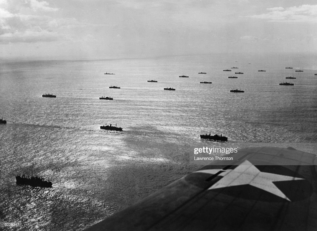 Aerial view from a fighter plane wing of a United Nations convoy on the Atlantic Ocean heading toward Africa World War II