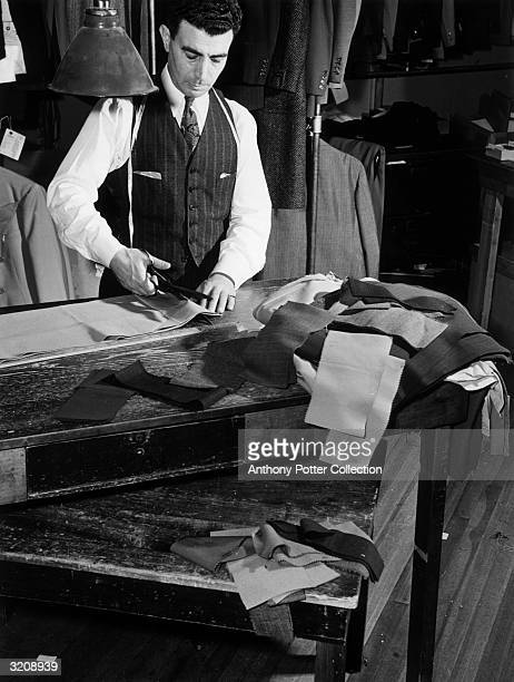 Complying with the War Production Board restrictions on use of materials for clothing a tailor measures and cuts men's trousers as though cuffs had...