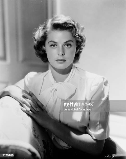 Film star Ingrid Bergman wearing a short sleeved blouse with a pussycat bow neckline