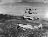 Four US Army P51 Mustang fighter airplanes of the 15th Fighter Command fly in formation over the countryside of Italy during World War II Its...