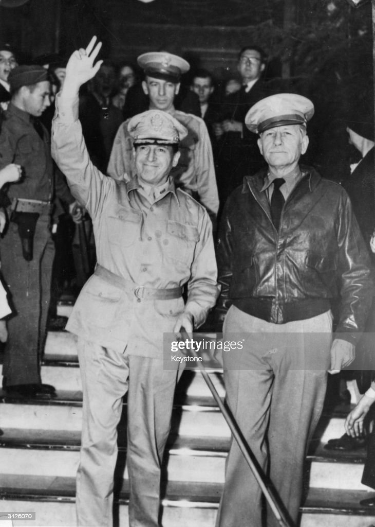 General MacArthur waving a greeting as he arrives in Australia to take command of the forces in the Pacific With him is General Patrick Hurley