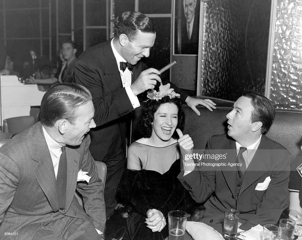 Gracie Allen the American comedienne in the company of her husband Fred Allen the radio comedian and fellow comedian Jack Haley while dining out at...