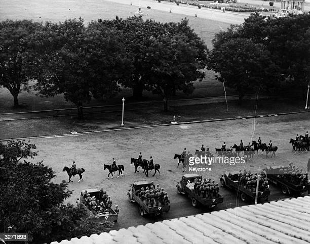 In Manila the Japanese hold a victory parade all to themselves General Masaharu Homma the leader and instigator of the death march in Bataan leads...