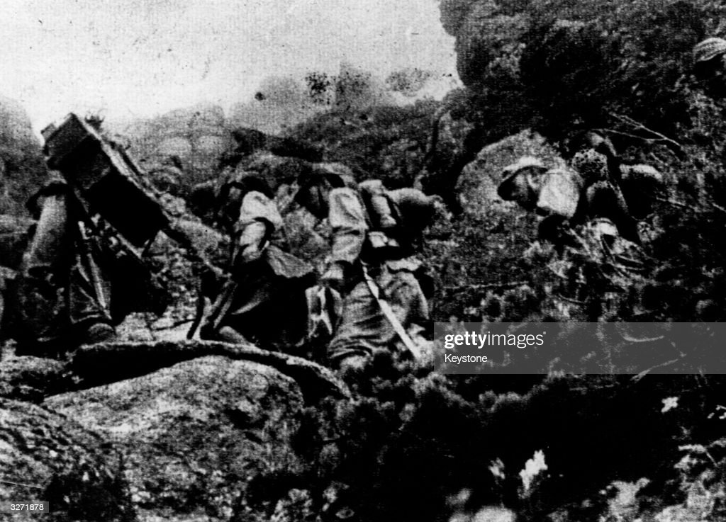 Japanese soldiers take a rest as they infiltrate Malaya through the mountain passes and jungle