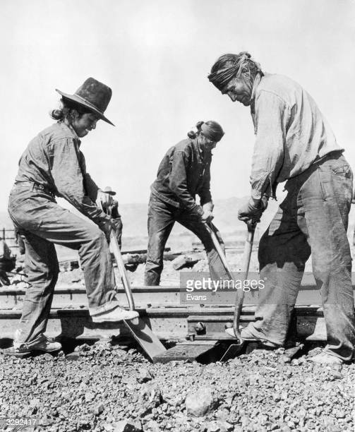 Navajo Indians are helping in the war effort by working as section hands on the Southern Pacific Railroad near Yuma Arizona
