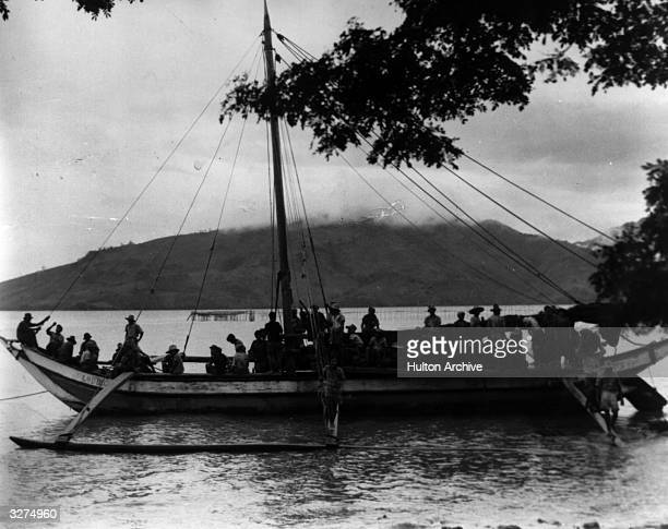Phillipine civilians are evacuated to safety from Leyte on a coastal sloop with an outrigger They did not return until the Japanese were routed by...