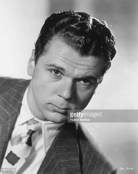 Promotional headshot portrait of American actor Jackie Cooper tilting his head forward and looking straight ahead for director A Edward Sutherland's...