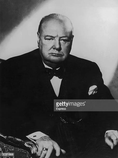 Studio portrait of British prime minister Winston Churchill sitting in an armchair