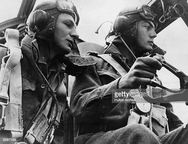 Two RAF pilots flying a bomber