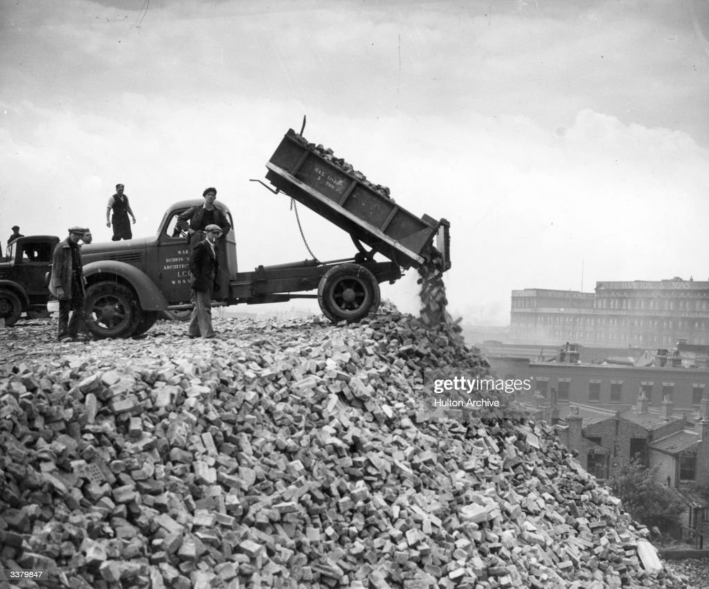 A lorry dumping damaged bricks from war torn houses on a brick recyling deposit dubbed 'Brick Hill' in Battersea South London